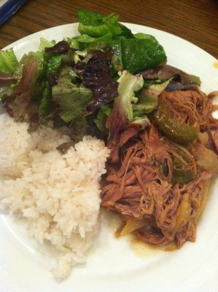 Ropa Vieja served with rice and salad