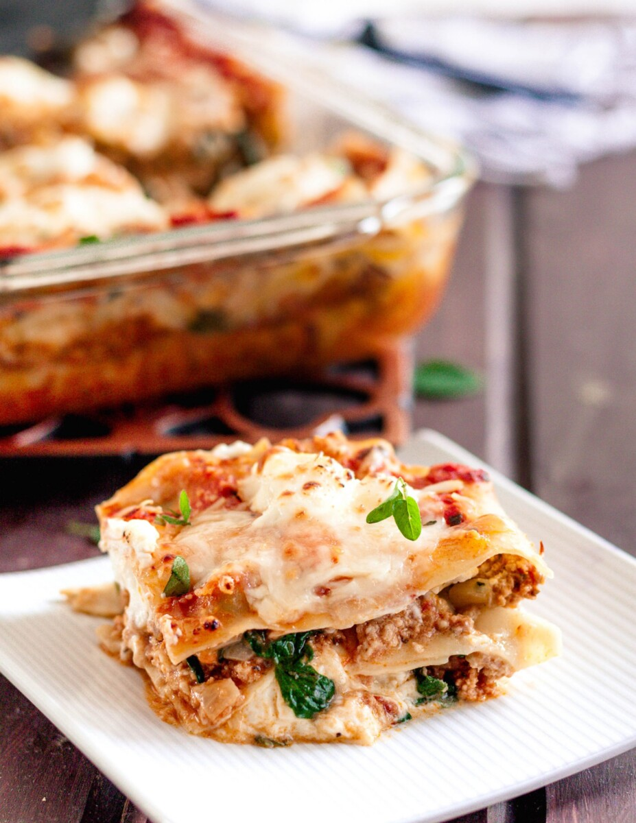 plated portion of the turkey spinach lasagna on a white square plate