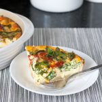 Easy Spanish Chorizo, Manchego, Spinach Quiche with an olive oil crust. With only minutes of active prep time, you can create an impressive dish perfect for a light meal. Get the recipe on GoodieGodmother.com