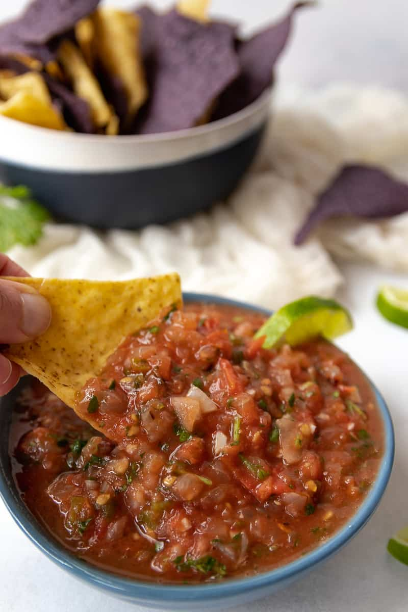 Restaurant style tomato salsa is perfect for dipping tortilla chips!