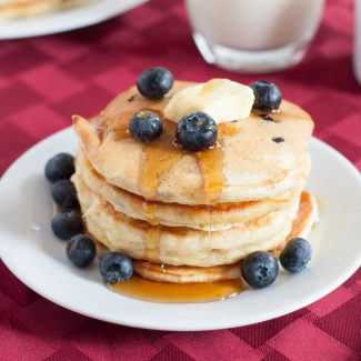 Make fluffy blueberry pancakes a little healthier by adding golden flax. Kid and husband approved! Recipe on GoodieGodmother.com