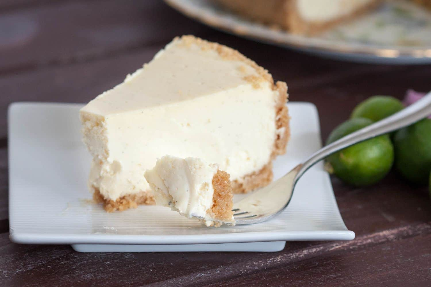 New York style key lime cheesecake recipe. Creamy without being heavy, with just the perfect touch of key lime flavor! Get the recipe on GoodieGodmother.com