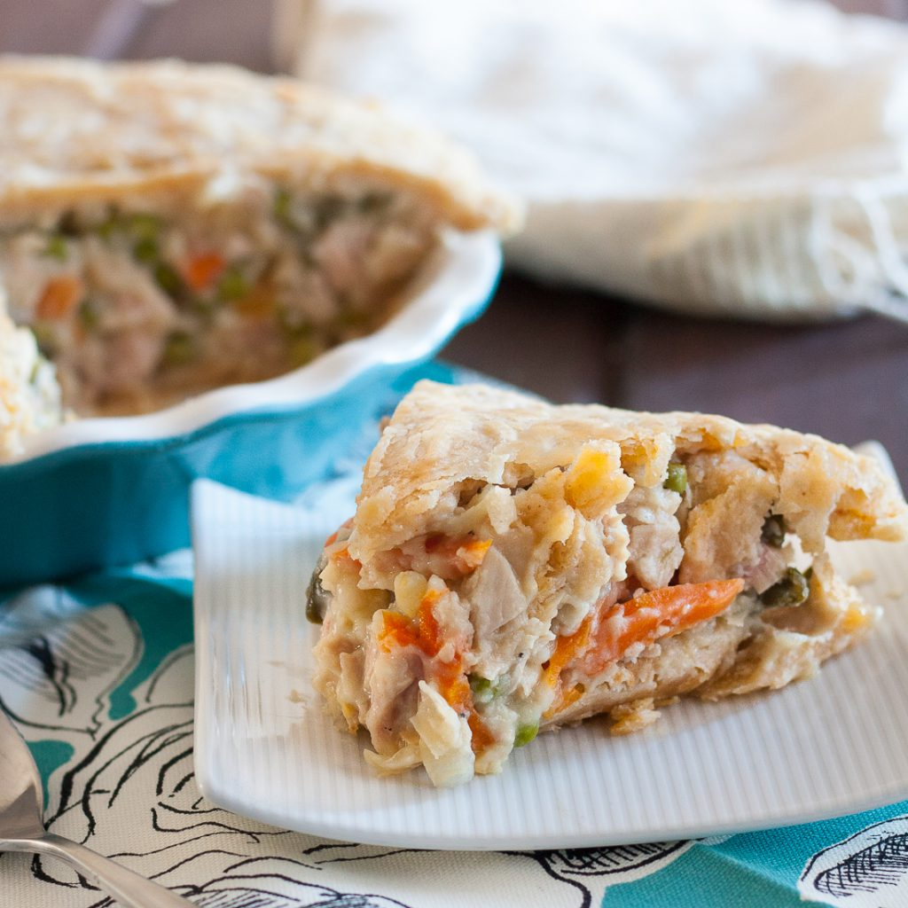 Turkey pot pie is one of our favorite ways to repurpose leftover Thanksgiving turkey! With an easy to make crust, and a tasty filling, you'll want to make 2 and freeze one for later! * Recipe on GoodieGodmother.com