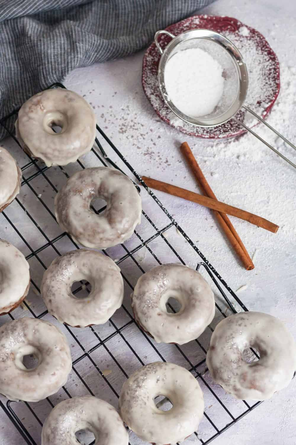 """Baked gingerbread doughnuts with a maple glaze are a higher protein """"nicer"""" Christmas breakfast treat! * Recipe on GoodieGodmother.com"""