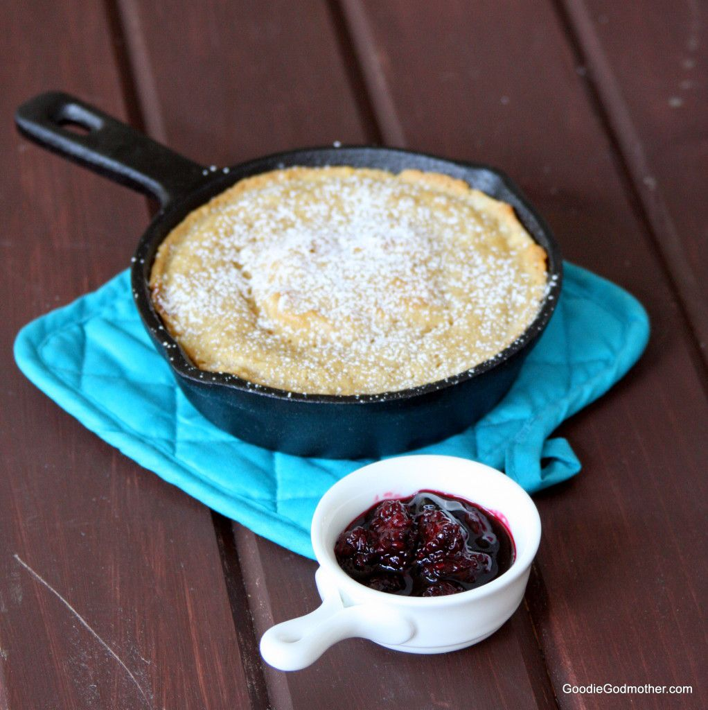 Baked skillet pancake with blackberry champagne compote