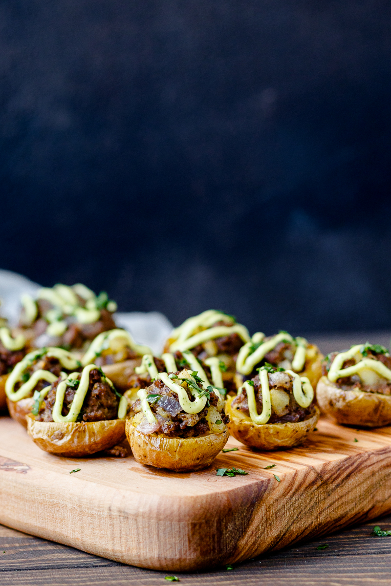 beef potato bites on a wooden serving tray