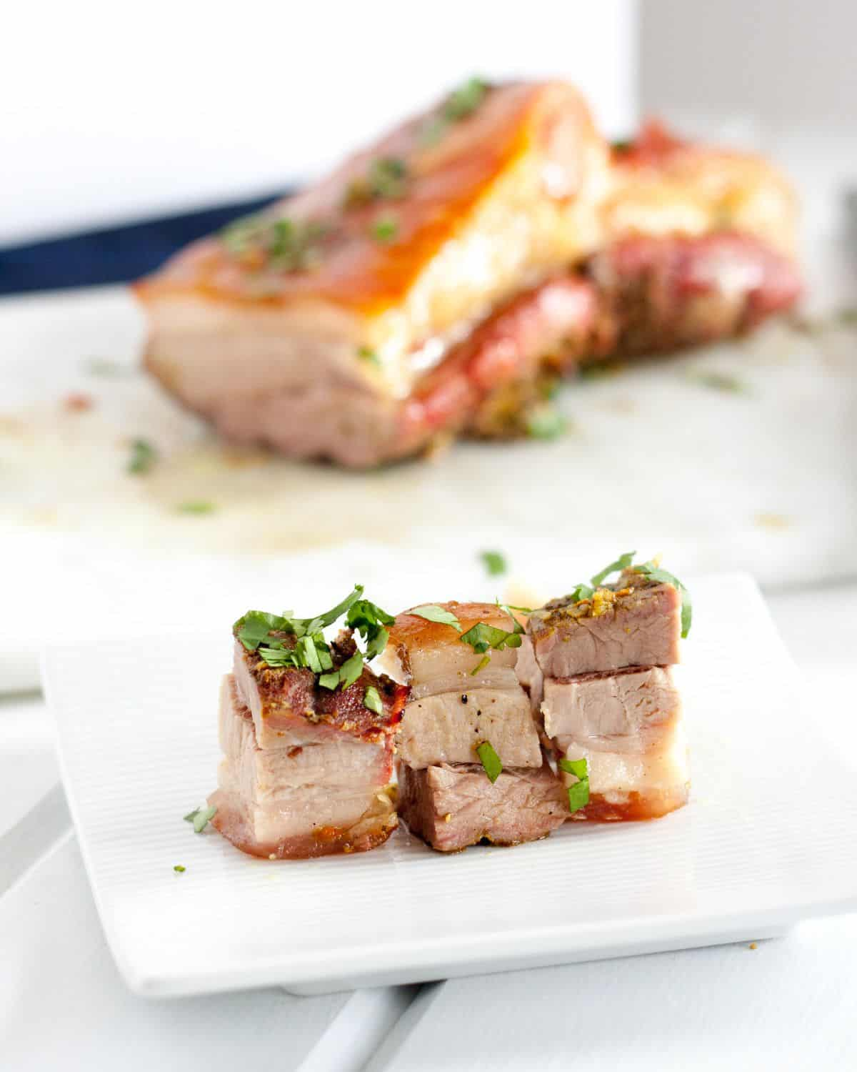 Crispy Pork Belly is easy to make in the oven. This recipe has a beautiful blend of flavors like tumeric, garlic, and cinnamon, so the leftovers are even better! Serve freshly roasted for Chinese New Year or cut into cubes and slices and pan fry for an extra crispy treat!
