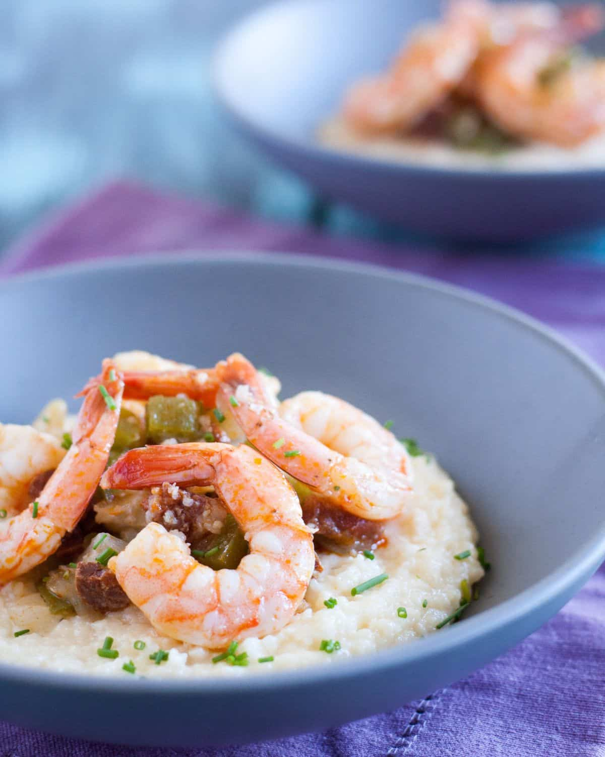 Shrimp and Grits is the perfect Southern comfort food. So delicious and easy to make at home from scratch! Get the recipe on GoodieGodmother.com