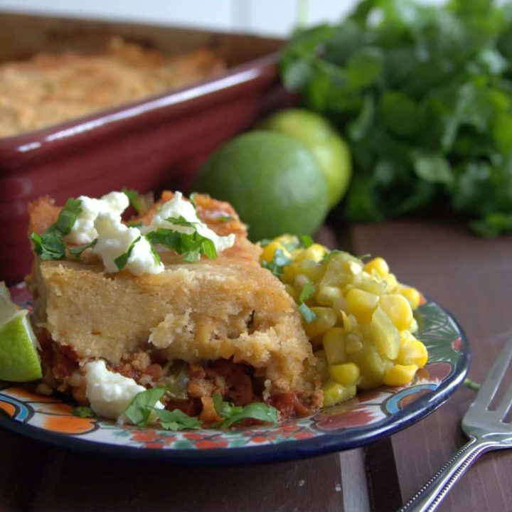 A delicious TexMex casserole, this Adobe Pie (also known as Tamale Pie) is an easier way to enjoy tamale flavors without all the rolling. It's freezer friendly too!