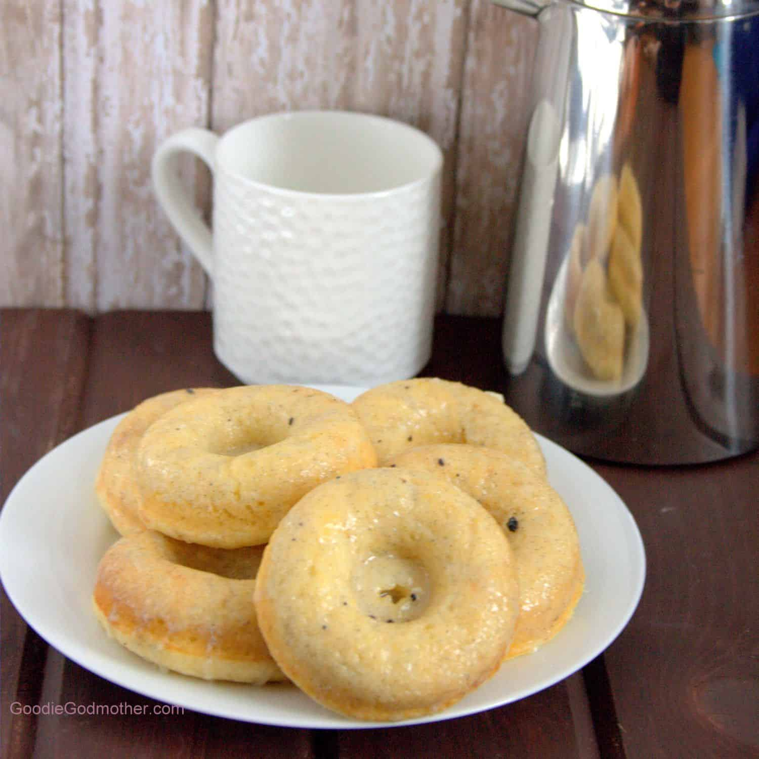 Baked Meyer lemon doughnut recipe with a vanilla bean white chocolate ganache glaze