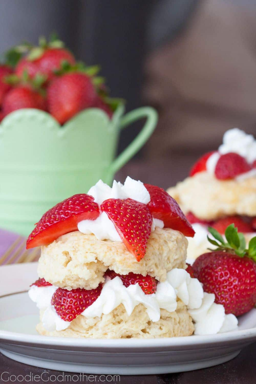 Easy strawberry shortcake recipe for summer! Perfectly textured shortcake layered with homemade whipped cream and bright red strawberries!