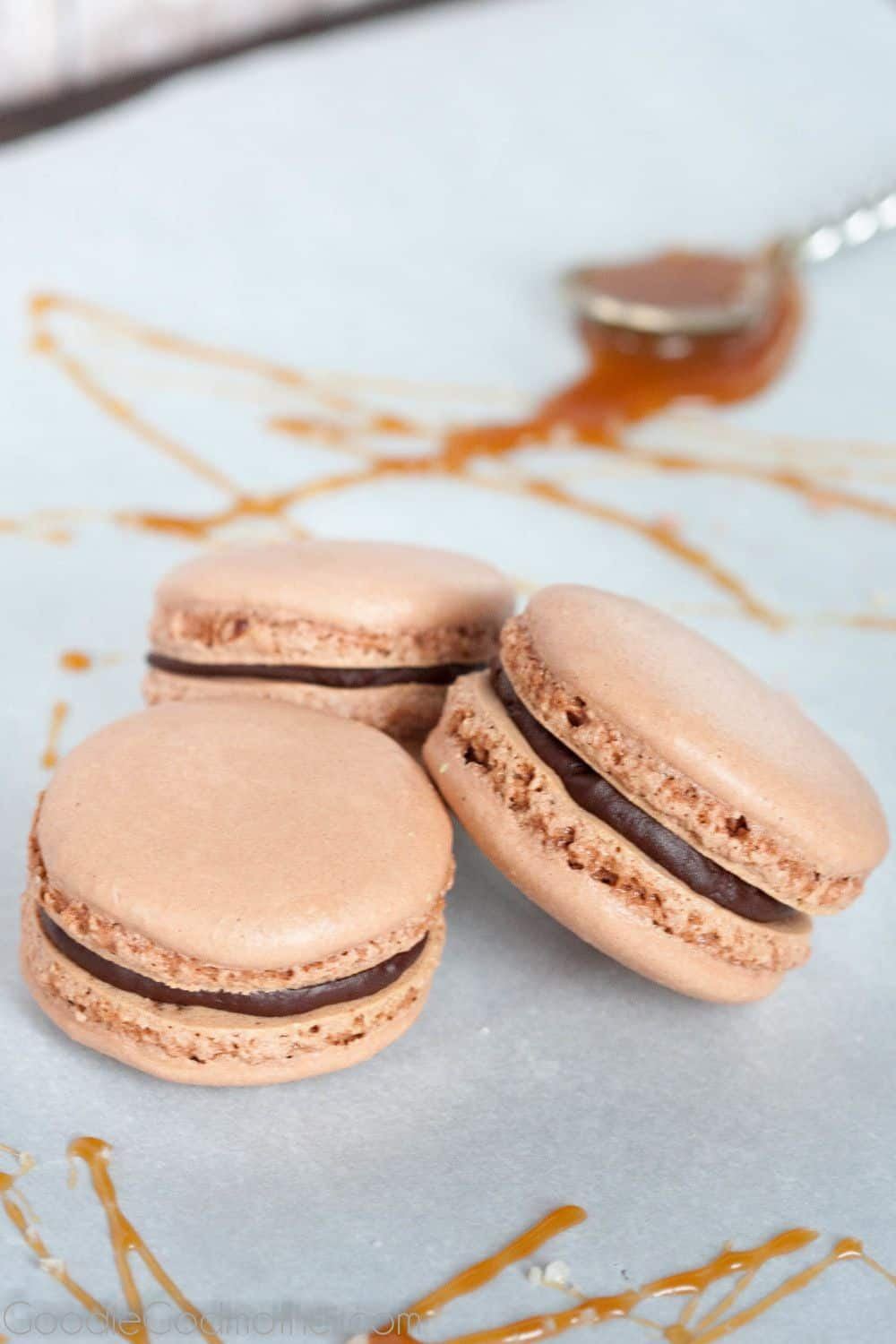 Bailey's caramel macarons - salted caramel goes to the next level with a little Irish cream, surrounded by dark chocolate ganache, and sandwiched in a macaron. Recipe on GoodieGodmother.com