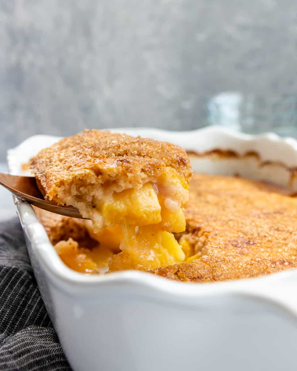 Fresh peach cobbler is a hallmark summertime recipe! You can make peach cobbler year round, but there's something extra special about a summer fruit cobbler with fresh peaches. Peach cobbler is a great easy recipe for summer entertaining. * GoodieGodmother.com