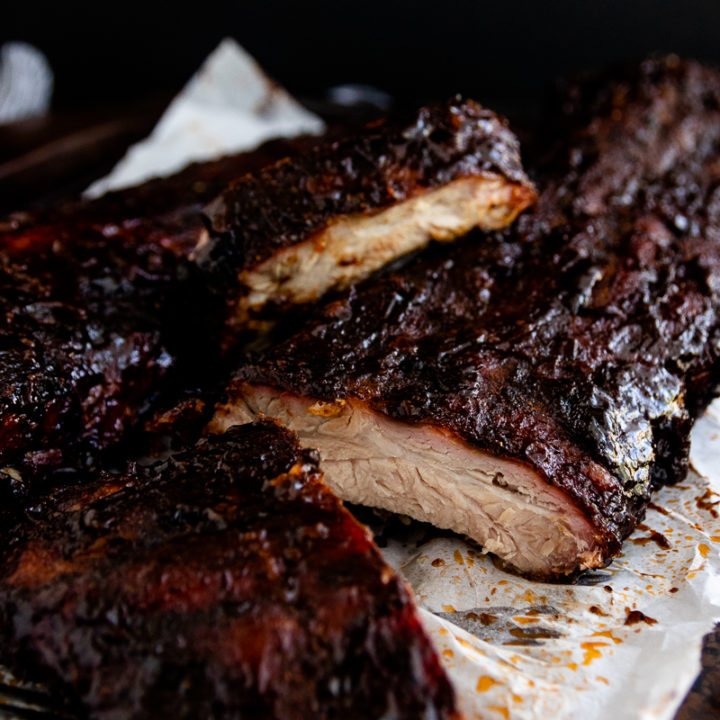 Kansas City Ribs, with their smoky, tomato-based, slightly spicy sauce are a perfect barbecue recipe. Make the sauce alone, or follow this recipe to learn how to convert your charcoal grill into a smoker to cook the ribs low and slow. #bbqrecipe #howtomake #foodideas #summerfood #bbqribs #barbecue