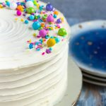 Naturally white, and easy to mix up with no special ingredients required, this white cake recipe from scratch is moist and delicious! Put down the box mix, and make white cake from scratch at home. * Recipe on GoodieGodmother.com #whitecake #weddingcake #birthdaycake #vanillacake