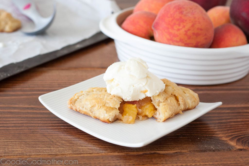 Summer peaches make a perfect filling for flaky peach hand pies with an all butter crust. Recipe on GoodieGodmother.com