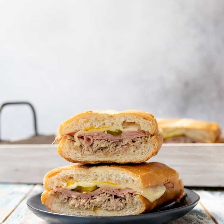 Enjoy Miami-worthy Cuban sandwiches at home with this easy and authentic Cuban sandwich recipe. The secret is in the pork, which you make in your slow cooker or pressure cooker! * Recipe on GoodieGodmother.com