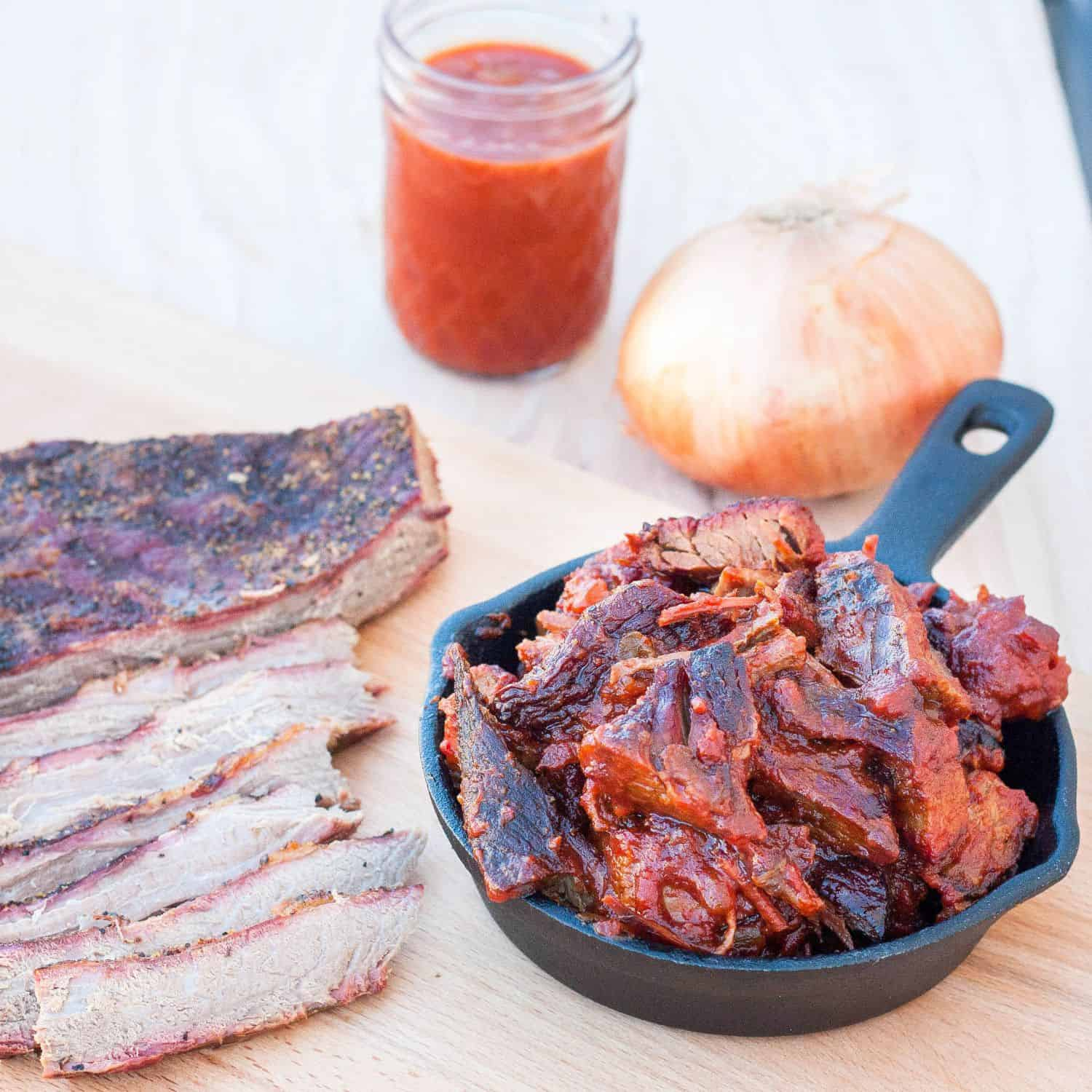 Learn how to make a butter-knife-tender brisket and burnt ends in a Saint Louis-style barbecue sauce. Recipe and directions on GoodieGodmother.com