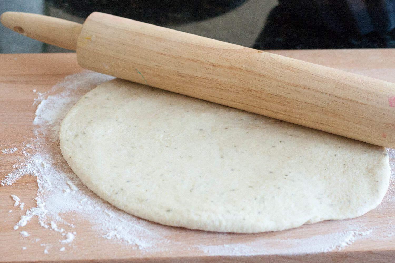 Super easy make-ahead pizza dough using your food processor! Recipe on GoodieGodmother.com