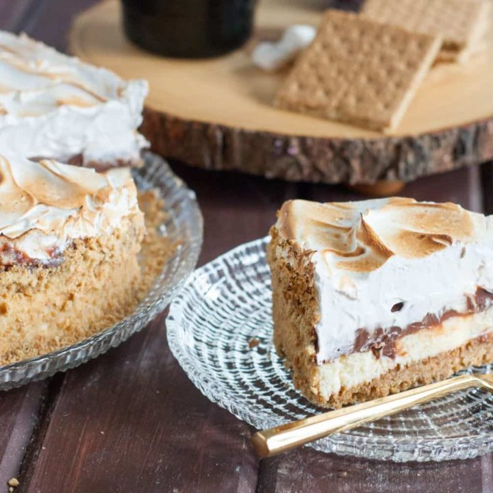 S'mores Cheesecake is a perfect anytime dessert. Love the creamy cheesecake topped with milk chocolate ganache and toasted marshmallow fluff. So so good!