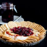 Baked brie is an impressive, yet easy holiday appetizer! This recipe tops the baked brie with a fresh cranberry balsamic compote that keeps you coming back for bite after bite!