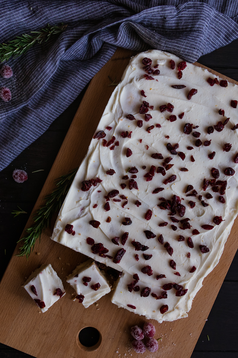 top view of cranberry orange bars on a cutting board
