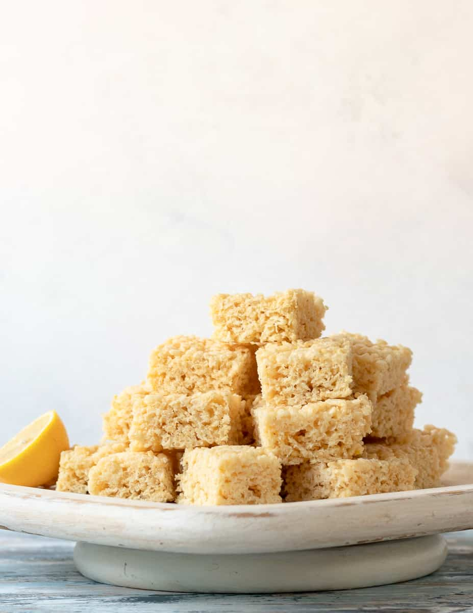 lemon crispy rice treats piled high on a square serving platter