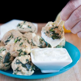 Gluten free turkey spinach feta meatballs with an easy lemon dipping sauce. Lower in fat than a classic meatball and loaded with natural protein. Includes a secret ingredient to keep the meatballs from drying out. ;)
