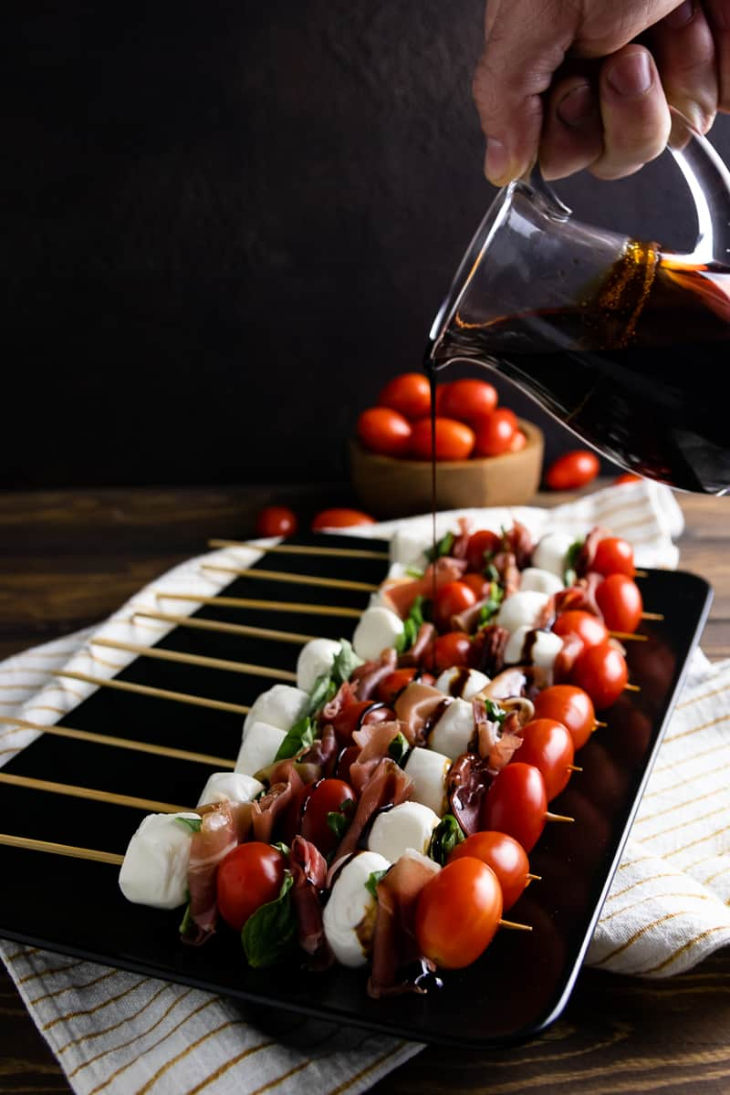 When you need a party appetizer in a pinch, these easy Italian salad skewers are the perfect recipe! Make a few or make a lot, they're a handheld version on the classic caprese salad! * Recipe on GoodieGodmother.com