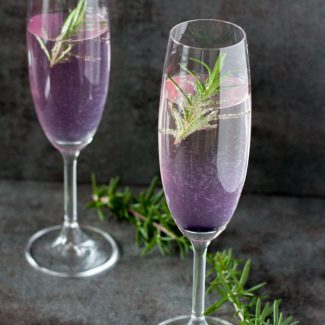 A refreshing New Year's Eve Cocktail! Get the color changing Rosemary 75 champagne cocktail recipe on GoodieGodmother.com