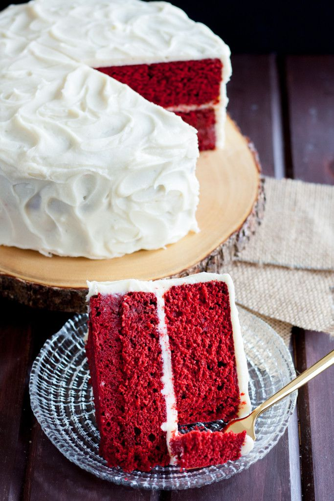 image of red velvet cake slice on a plate with a gold fork