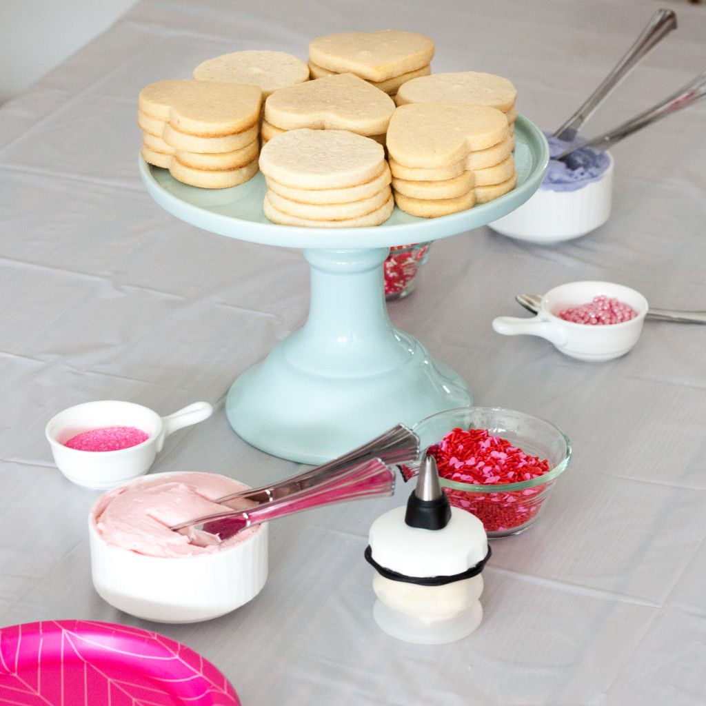 Everything you need to know to plan a STRESS FREE Valentine's Day cookie decorating party for toddlers. This play date party is a sweet way to celebrate Valentine's Day and a fun indoor activity for winter weather.