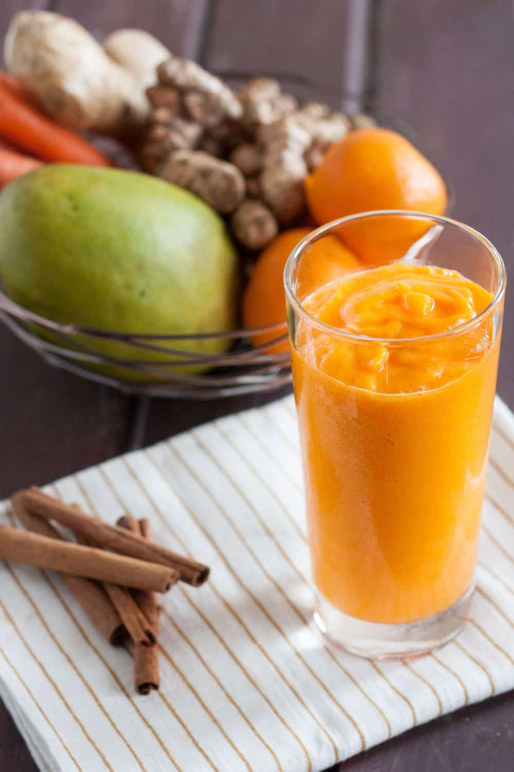 Fresh turmeric smoothie recipe - Mango, fresh turmeric, carrots, ginger, and more make this vitamin and antioxidant loaded vegan smoothie a delicious way to start the day!