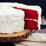 Perfect Red Velvet Cake Recipe FROM SCRATCH! Just the right hint of chocolate with a kick, it's everything you'd want from a classic Southern red velvet. Bakes perfectly as a layer cake or cupcakes with no modification. Recipe on GoodieGodmother.com