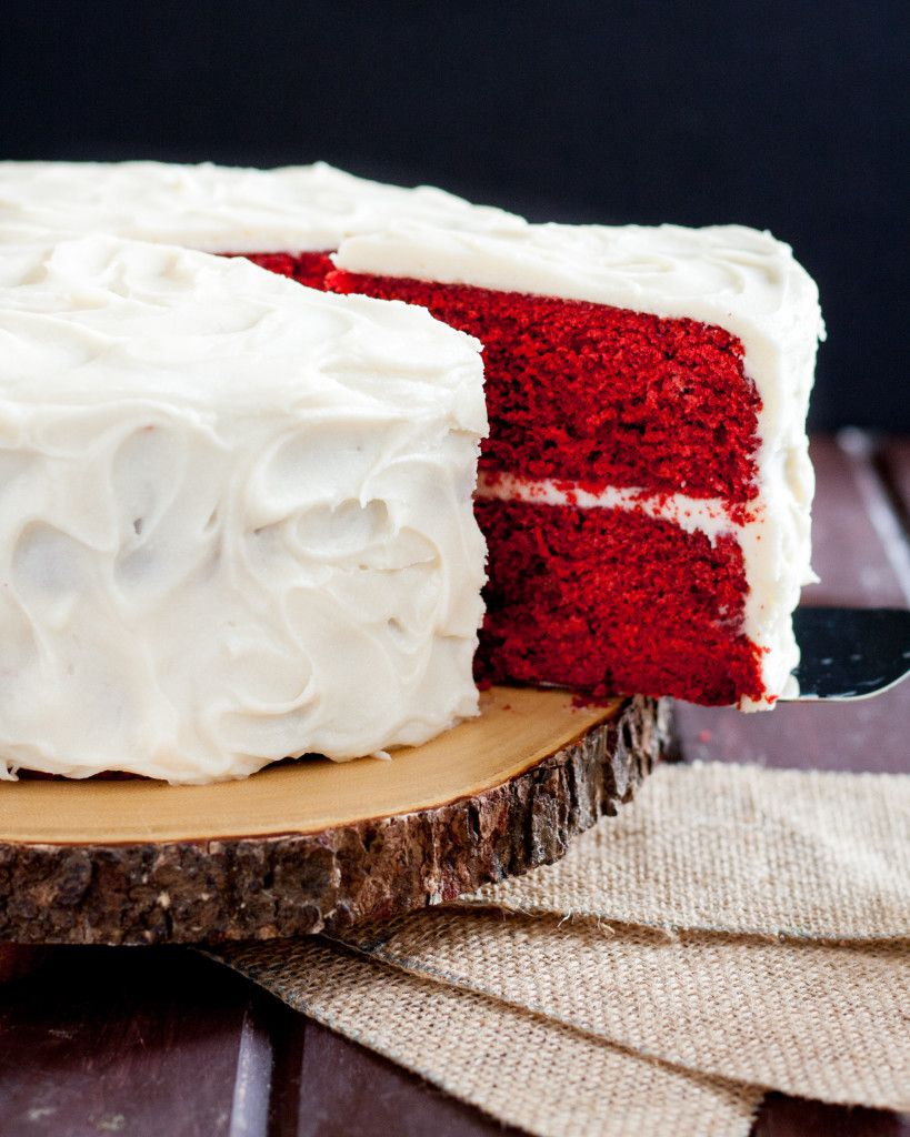 Close up of a cake server pulling a slice of cake out