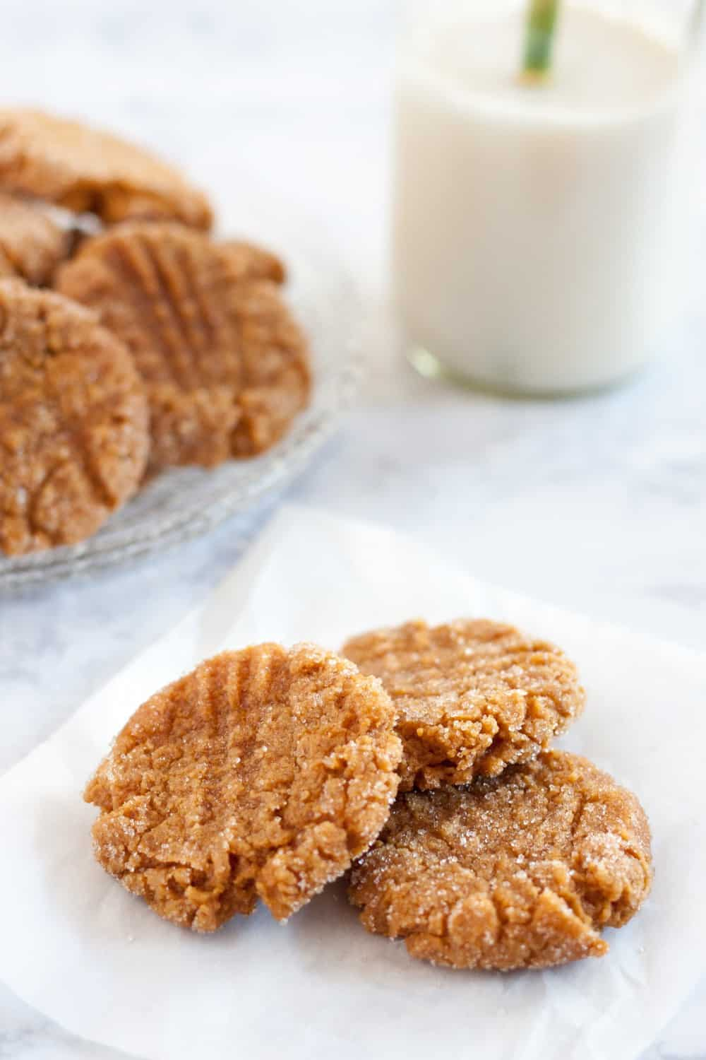 Irrisistable, these soft vegan peanut butter cookies have a secret ingredient to make them just a bit better for you. ;) Recipe on GoodieGodmother.com