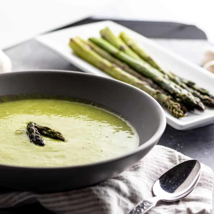 Welcome the coming of warmer days, even on cooler evenings, with this delicious Asparagus Garlic Soup. It's one of my favorite easy asparagus recipes to enjoy during asparagus season!