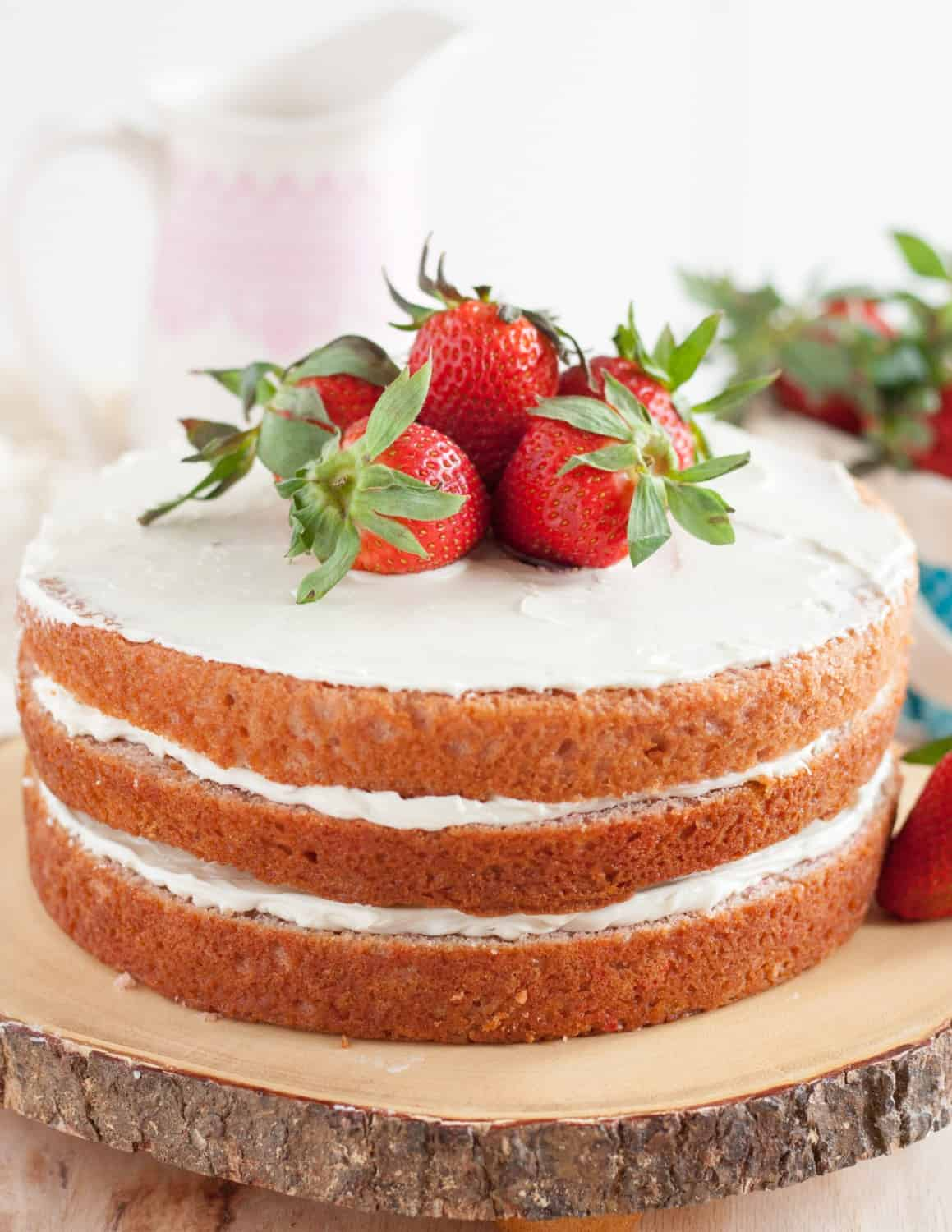No artificial colors, all natural flavor, this fresh strawberry cake from scratch is a perfect dessert for strawberry season! * GoodieGodmother.com