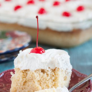 Tres Leches Cake - Three Milks Cake - is an easy and popular poke cake in Latin America. Try this recipe and you'll see why! * GoodieGodmother.com