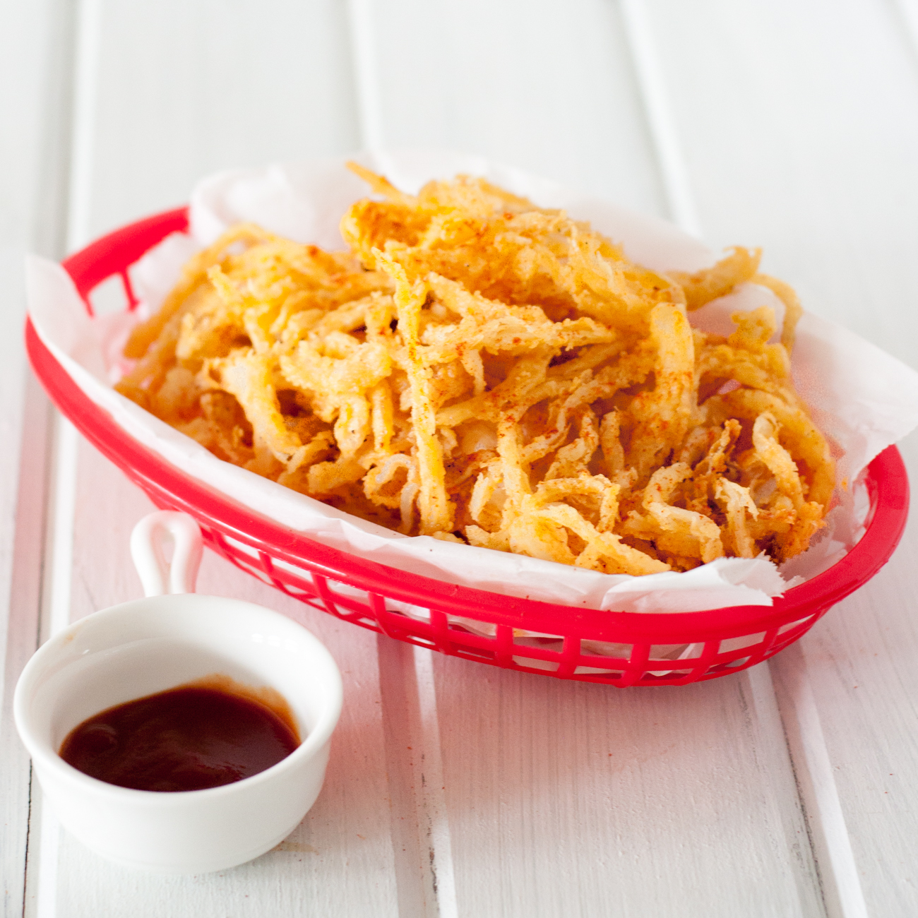 Crispy smoked paprika onion straws are an easy and delicious addition to burgers, salads, steaks, sandwiches, or a fun snack to enjoy just because. Recipe found on GoodieGodmother.com