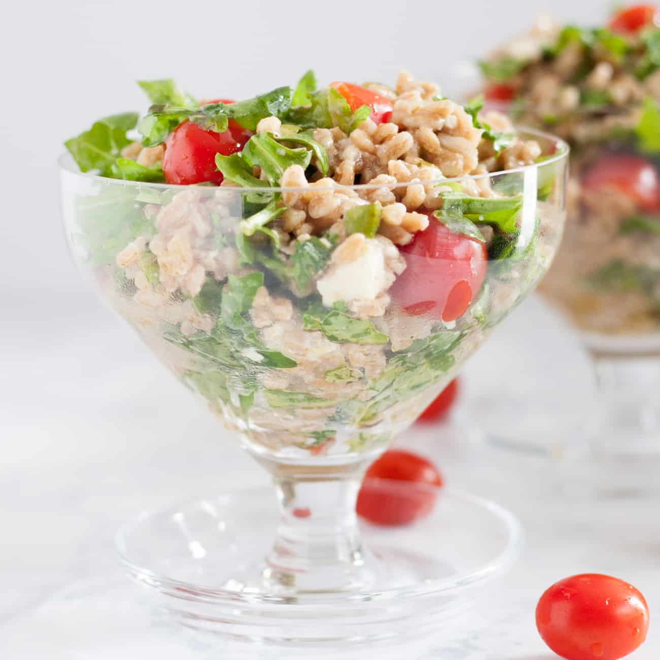 Bright Mediterranean inspired flavors make this feta farro salad a perfect main dish for a light meal, or a refreshing side for a picnic or barbecue. It's a great way to try ancient grains in your diet! * Recipe on GoodieGodmother.com