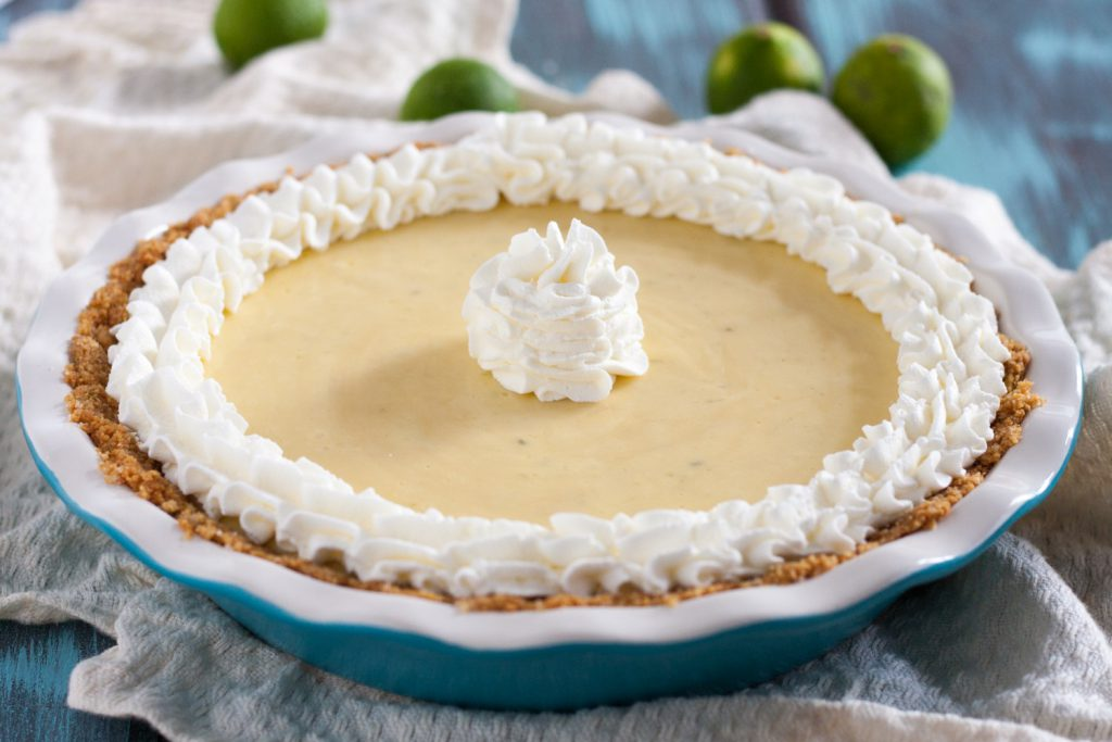 Key Lime Pie is a quintessential summer dessert! Enjoy this easy creamy tart version anytime you need to find yourself in a Key West frame of mind! * GoodieGodmother.com