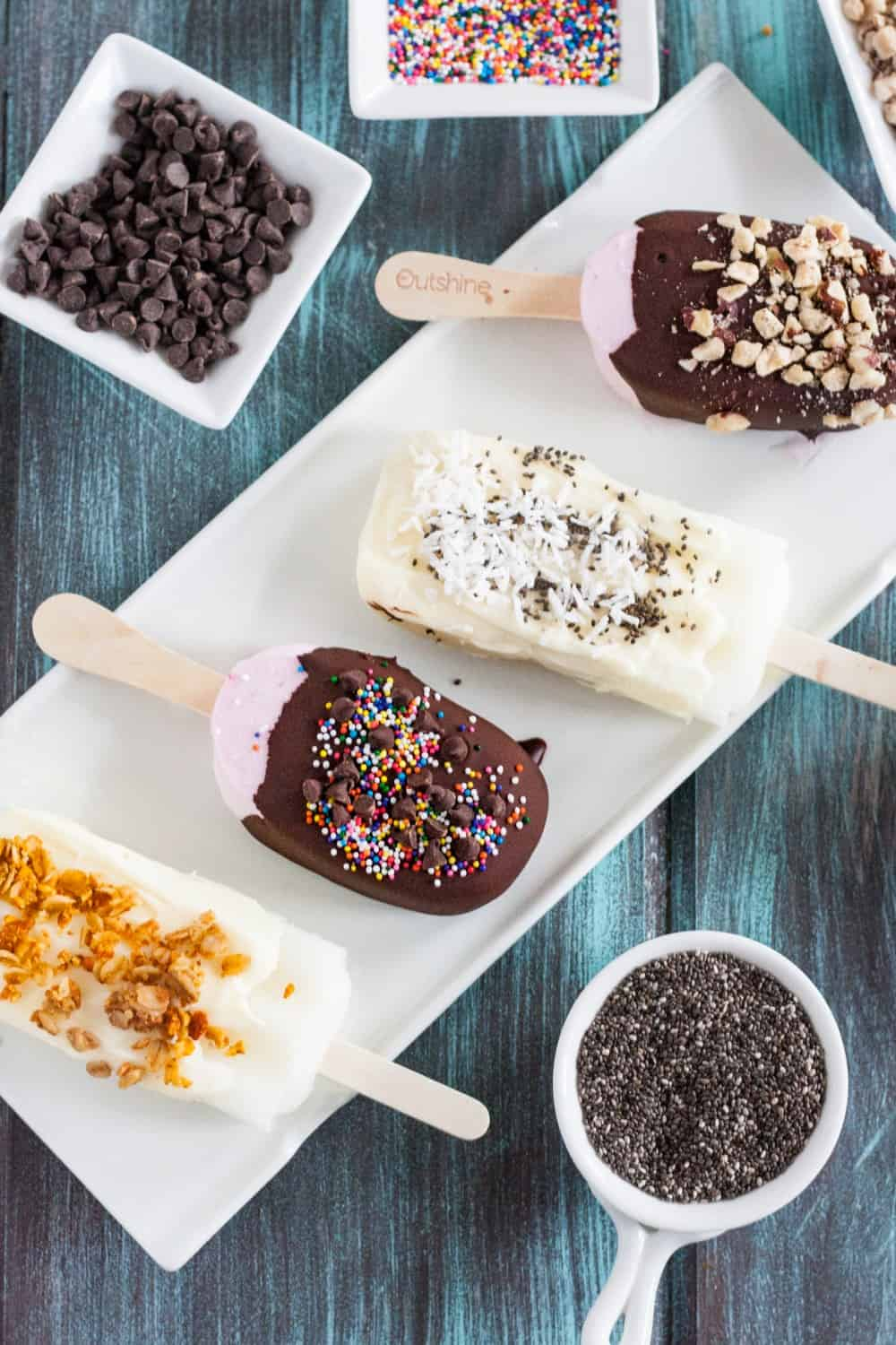 Set up a chocolate dipping station for fruit pops at your next summer party! It's an easy and interactive dessert your guests will love! #ad #SnackBrighter