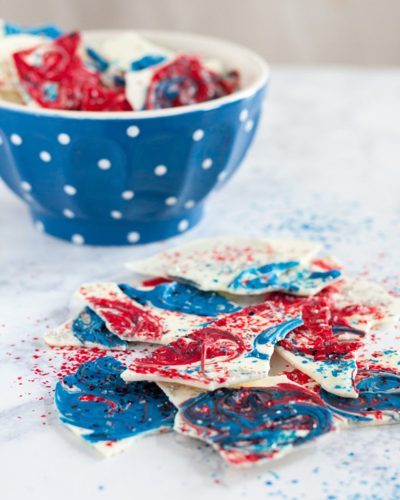 This fireworks inspired bark is a simple no bake dessert perfect to make with kids for any patriotic holiday. * How-to and video on GoodieGodmother.com