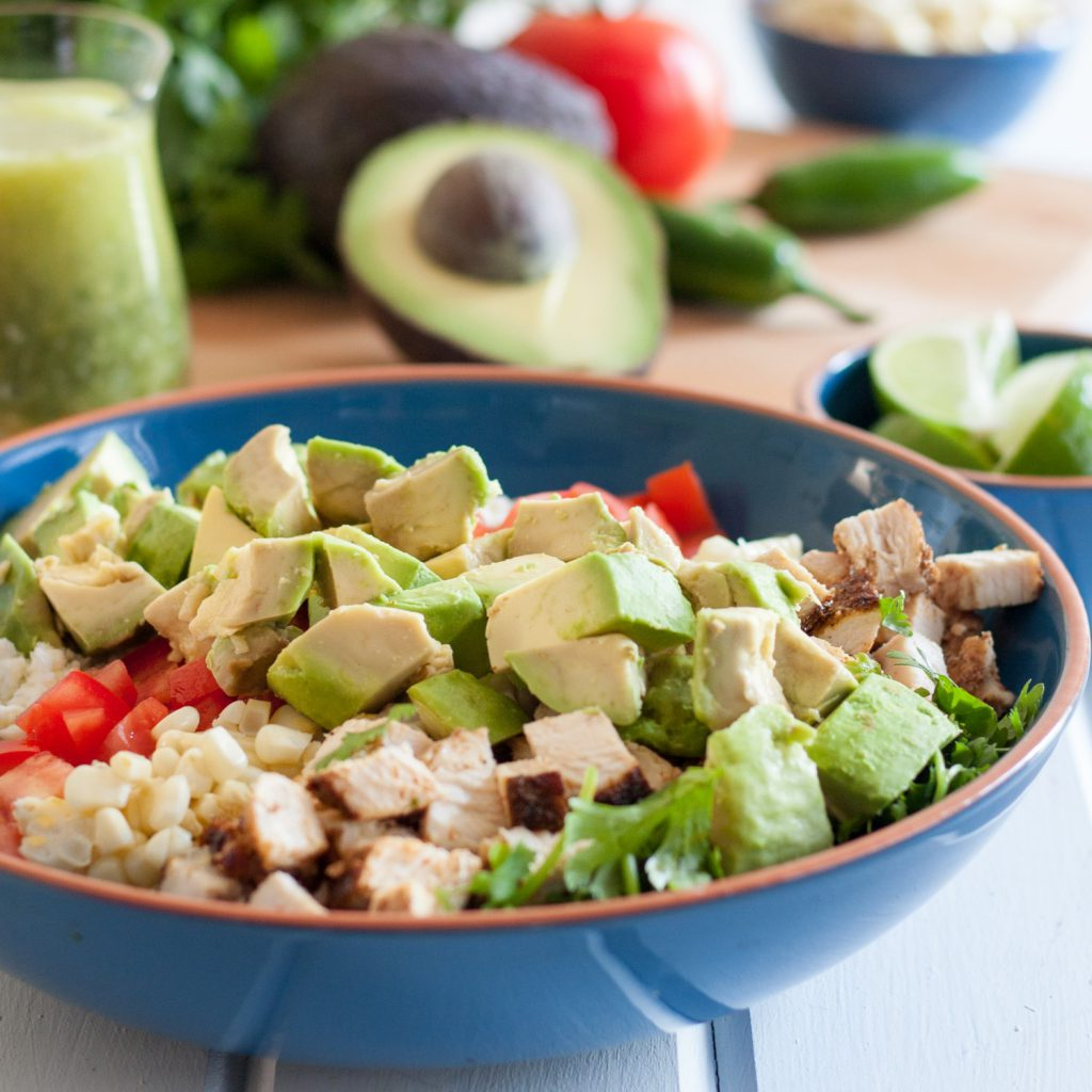 Fresh flavors shine in this Mexican Cobb Salad with a jalapeno basil vinaigrette! #ad #VidaAguacate * Recipe on GoodieGodmother.com
