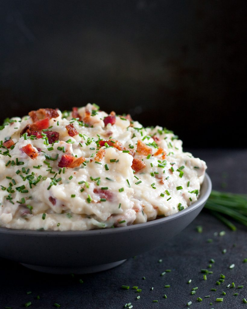 Bacon Brie Mashed Potatoes - Creamy, indulgent, totally loaded mashed potatoes. * Recipe on GoodieGodmother.com