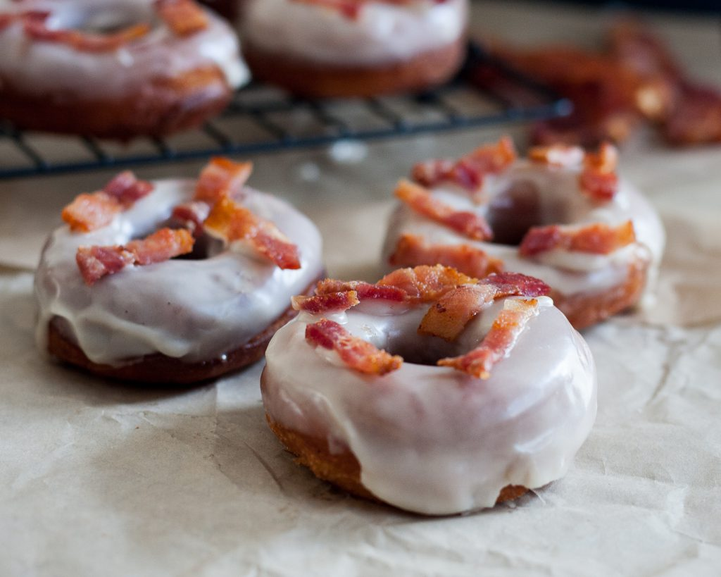Sweet and salty are a wonderful combination and make these maple bacon doughnuts a treat that won't last long! Recipe on GoodieGodmother.com