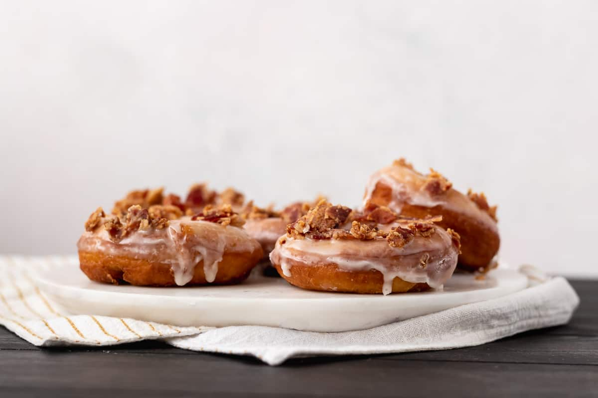 Sweet and salty are a wonderful combination and make these maple bacon doughnuts a treat that won't last long!