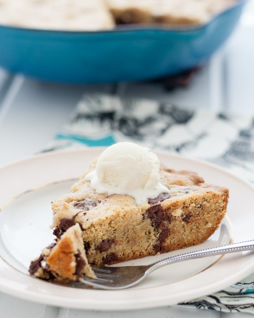 Break out the cast iron and make an Earl Grey chocolate chip skillet cookie! This easy cookie cake is a perfect cool weather comfort dessert. * Recipe on GoodieGodmother.com