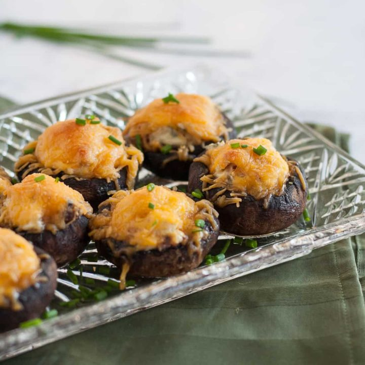 Bacon cheddar stuffed mushrooms are an easy party appetizer you can prepare ahead of time! * Recipe on GoodieGodmother.com